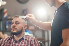 Young man at the barbershop Stock Photography