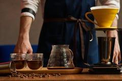 Professional Barista or coffee barman prepares coffee royalty free stock photo