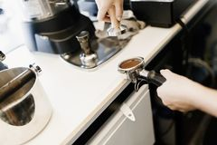 Barista making fresh coffee with machine. Professional barista making fresh coffee with machine Royalty Free Stock Images