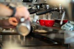 Barista making fresh coffee with machine. Professional barista making fresh coffee with machine Royalty Free Stock Photos