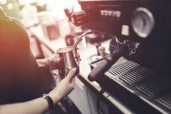 Barista making fresh coffee with machine. Professional barista making fresh coffee with machine Stock Photo