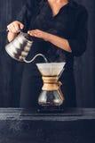 Professional barista preparing coffee. Alternative method Stock Image