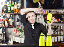 Professional barmen making cocktail Stock Photos