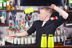 Professional barmen making cocktail Stock Photography