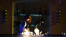 Professional bartender making cool, amazing tricks stock footage