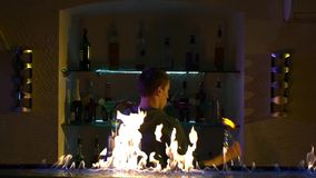 Professional bartender making cool, amazing tricks stock video