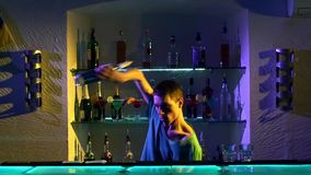 Professional bartender making cool, amazing tricks stock video footage
