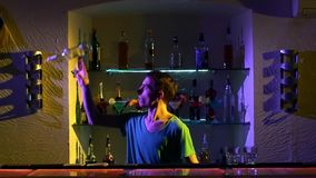 Professional bartender making cool tricks with two stock footage