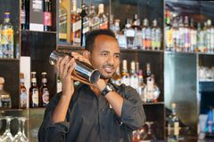 Male bartender makes a cocktail royalty free stock photos