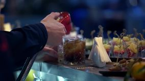 Professional bartender preparing a cocktail with ice a mix of alcohol. The barman measure quantities for a perfect. Cocktail and mixes all together stock video