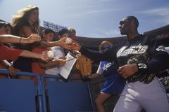 Professional Baseball player. Signing autographs and balls for young fans, Dodger Stadium, Los Angeles, CA Royalty Free Stock Photography