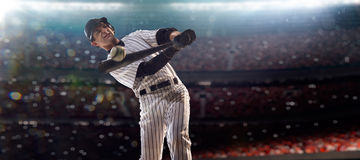 Professional baseball player in action. On grand arena royalty free stock image