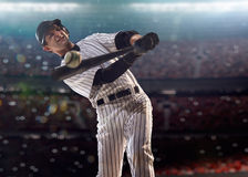 Professional baseball player in action. On grand arena Stock Images