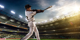 Professional baseball player in action. On grand arena Royalty Free Stock Photo