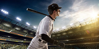 Professional baseball player in action. On grand arena royalty free stock photos