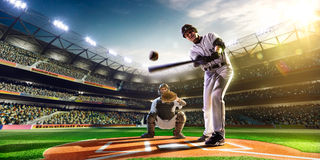 Professional baseball players on grand arena stock images