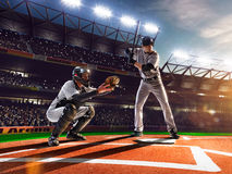 Professional baseball players on grand arena. Professional baseball players on the grand arena royalty free stock photography