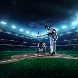 Professional baseball players on  grand arena. Professional baseball players on the grand arena Stock Images