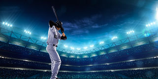 Professional baseball players on night grand arena Royalty Free Stock Photo