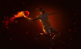Professional basketball player with fireball. Professional basketball player is shoting the fireball royalty free stock photos