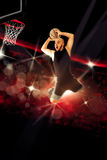 Professional basketball player makes a slam dunk in the game Royalty Free Stock Image