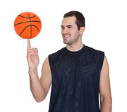 Professional basketball player spinning ball. On his finger. Isolated on white Stock Image