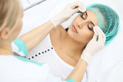 Free Professional Beautician And Young Woman In Beauty Salon. Makeup Artist Touch Customer Skin With Cotton Pads, Closeu Royalty Free Stock Photo - 115905655