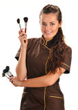Professional beautician holding brushes Stock Image