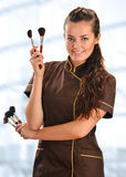 Professional beautician holding brushes Royalty Free Stock Photo