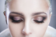 Professional beauty eyes makeup. Make up closeup. Long eyelashes and perfect skin. On a gray background Royalty Free Stock Photography