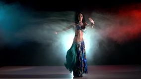 Professional belly dancer in a blue stage costume stock footage