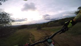 Professional biker biking riding extreme sport mountain bike downhill dangerous countryside road in 4k first person pov stock footage