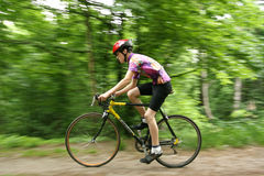 Professional biker with bured background. UKRAINE, KIEV - MAY 30: Vitaliy Kuznetsov with blurred background, at the child amateur bicycle competition We are the Royalty Free Stock Photo