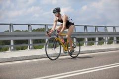 Professional biker riding on race bike Stock Photos