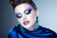 Professional blue make-up and hairstyle on beautiful woman face - studio beauty shot Royalty Free Stock Photo