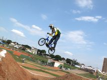 Professional bmx rider warms up for the local finals. Jumping over obstacles Stock Images