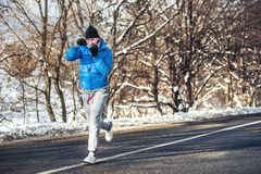 Professional boxer and athlete working out outdoor on snow and cold Royalty Free Stock Image