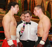 Professional boxing. CHELYABINSK - JANUARY 27: Boxers Petrov O. and Elin V. are greeting each other prior to the match on Jan. 7, 2011 in Chelyabinsk, Russia Stock Photos
