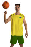 Professional Brazilian basketball player with ball. Royalty Free Stock Images
