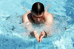 Professional Breaststroke Swimmer. In the outdoor pool Royalty Free Stock Images