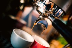 Professional brewing - coffee bar details. Espresso details coffee pouring from espresso machine. Barista details in cafe shop royalty free stock photos