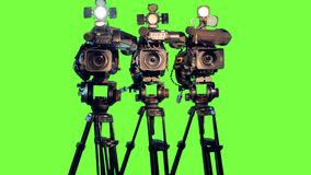 Professional broadcast studio video cameras on green screen. 4K stock footage