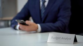 Professional budget analyst chatting on smartphone, discussing business news. Stock photo stock images