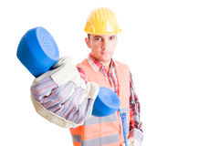 Professional builder handing phone Royalty Free Stock Photography