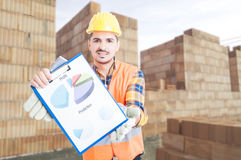 Professional builder holding clipboard with charts Stock Photography