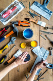 Professional builder work with house renovation instruments on wooden background top view. Professional builder work desk with house renovation instruments on royalty free stock image