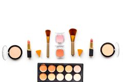 Professional bulk cosmetics pattern. Eyeshadows, rouge, brushes on white background top view copyspace Royalty Free Stock Image