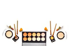 Professional bulk cosmetics pattern. Eyeshadows, rouge, brushes on white background top view copyspace Stock Image