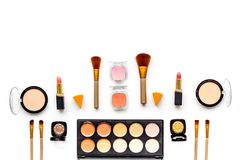 Professional bulk cosmetics pattern. Eyeshadows, rouge, brushes on white background top view copyspace Royalty Free Stock Photos