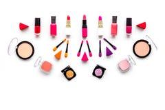 Decorative cosmetics pattern. Eyeshadows, rouge, applicators. lipstick, nailpolish on white background top view Stock Photo